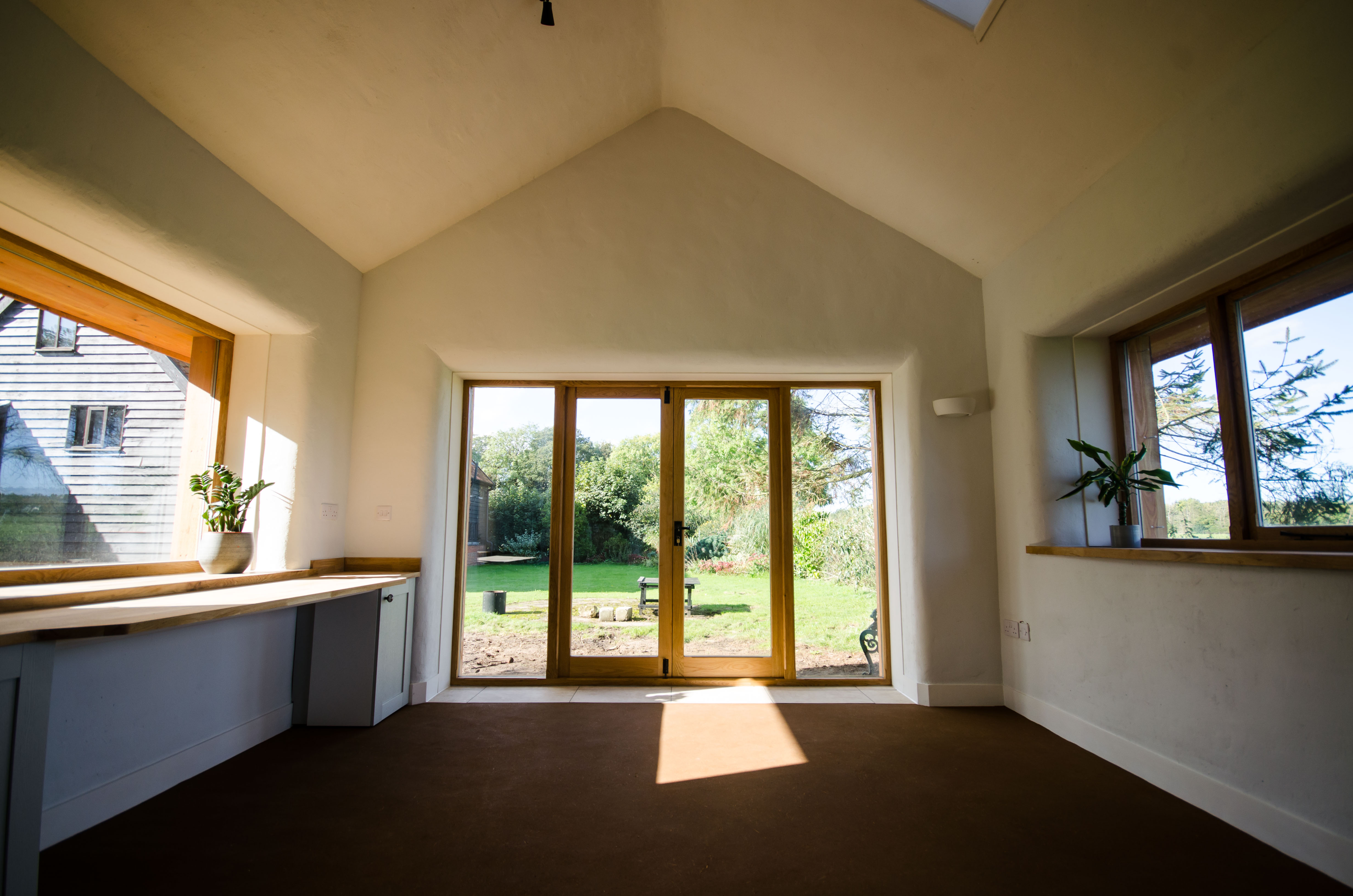 Straw bale house with earth floors and clay plasters