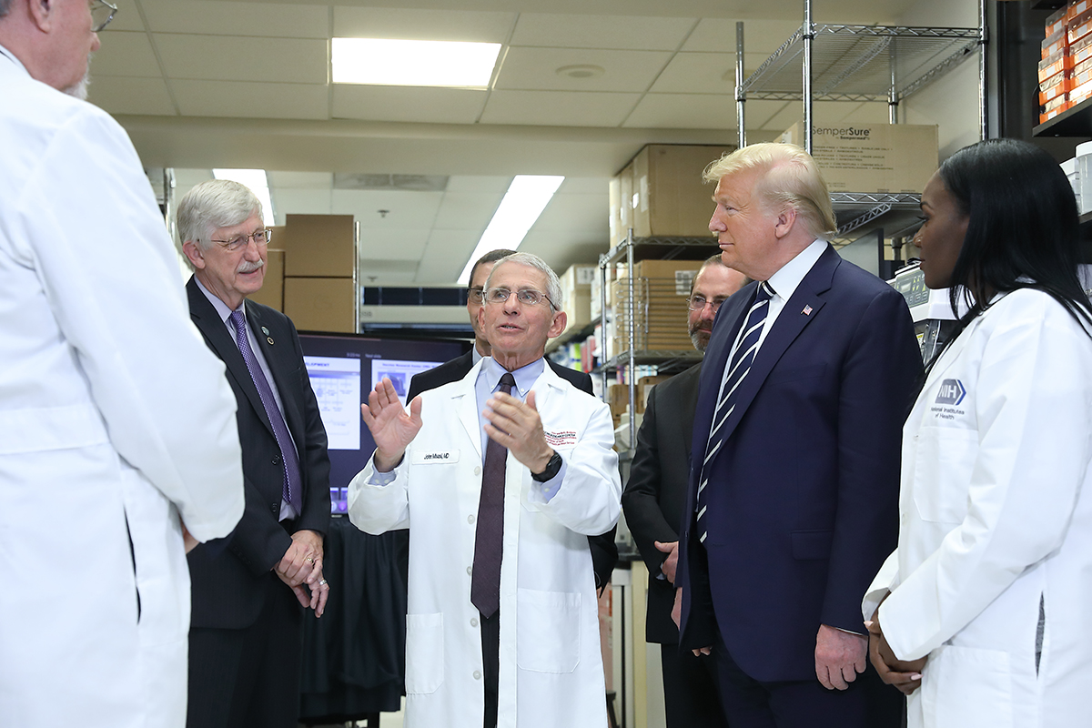 President Donald Trump visits NIH on March 3, 2020 and tours the National Institute of Allergy and Infectious Diseases' Vaccine Research Center (VRC) to learn about research on a vaccine for the novel coronavirus SARS-CoV-2. From left: VRC Deputy Director Dr. Barney Graham, NIH Director Dr. Francis Collins, VRC Director John Mascola, Department of Health and Human Services Secretary Alex Azar, President Trump, and VRC Research Fellow Dr. Kizzmekia Corbett.