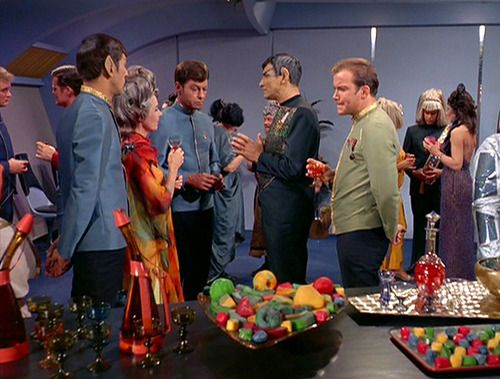 Kirk, Spock and Sarek at a dinner party on the USS Enterprise