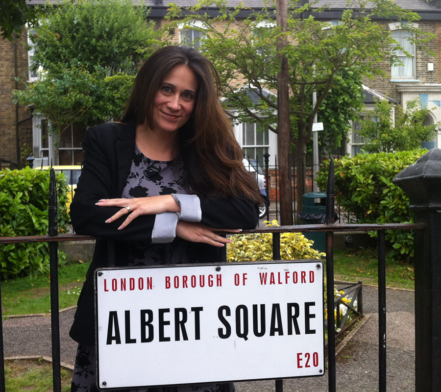 Genevieve standing in Albert Square on the set of EastEnders