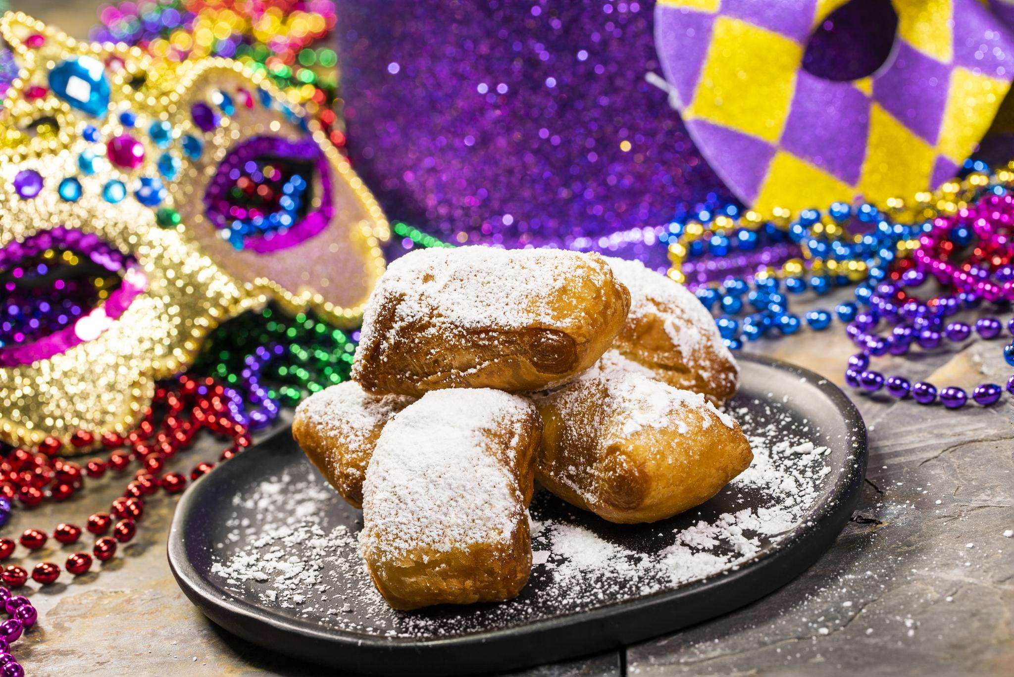 Hot and fresh beignets are a festival staple for Busch Gardens' Mardi Gras