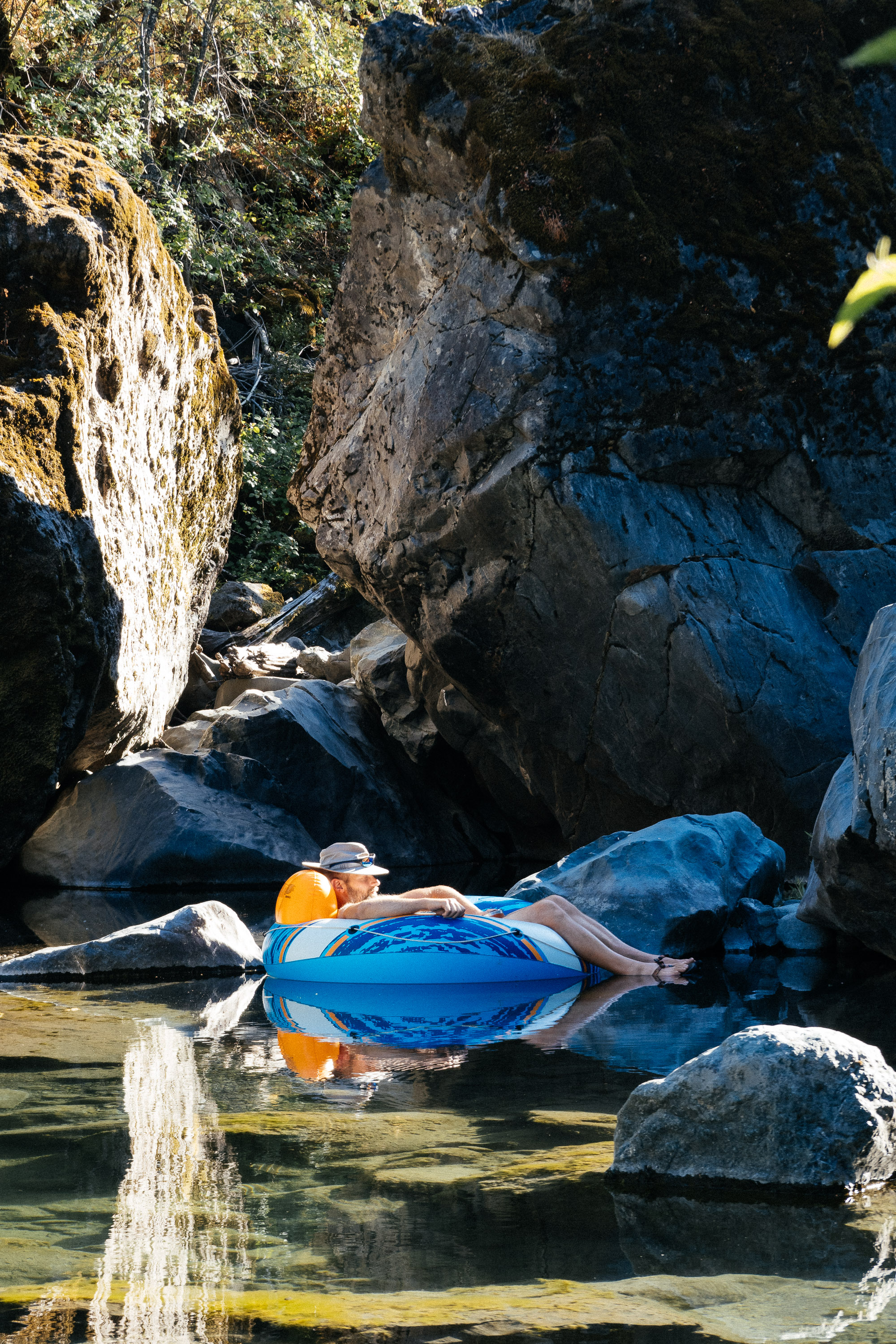 joe floating in the swimming hole
