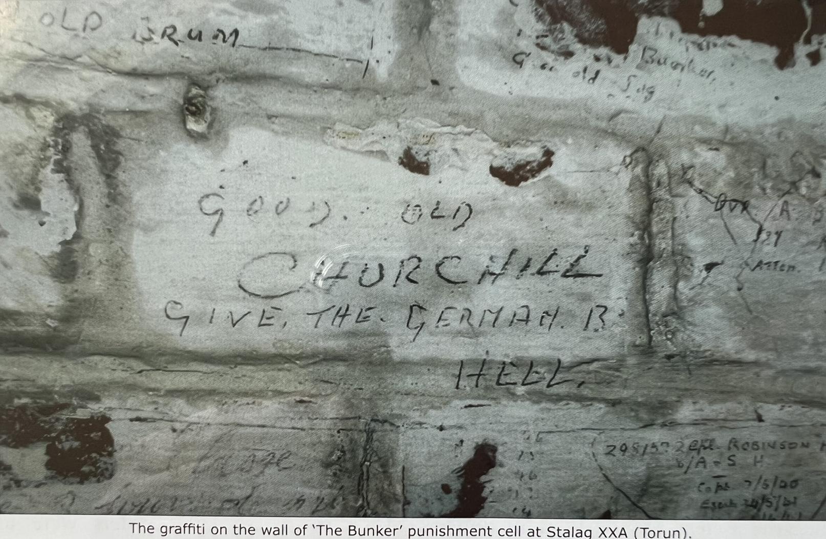 POW graffiti on wall at Stalag XXA