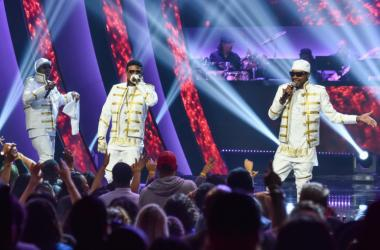 """K-Ci, JoJo and Dalvin of Jodeci onstage at """"Showtime at the Apollo"""" at the Apollo Theater on November 30, 2016 in New York City."""