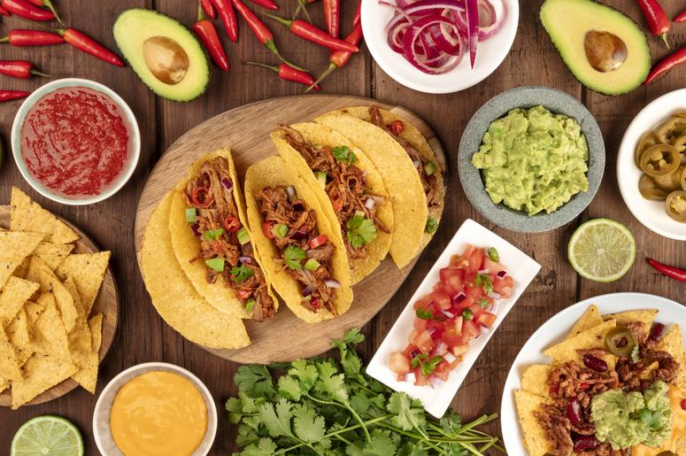 A plate of tacos and condiments
