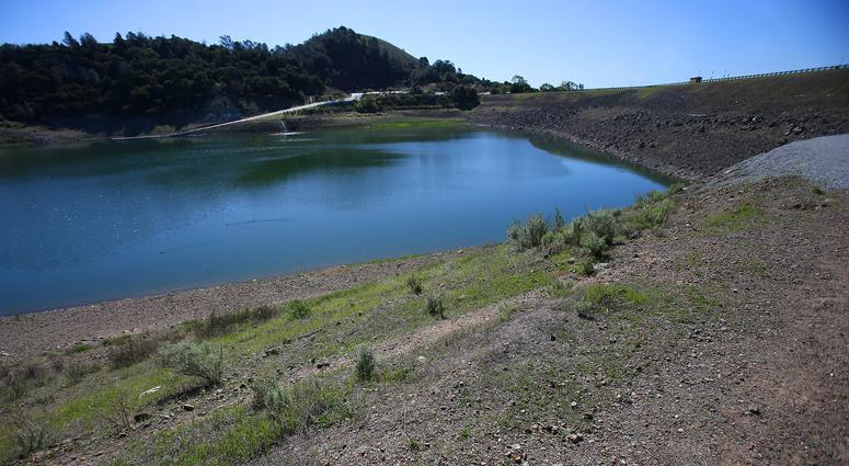 Anderson Dam is photographed, March 13, 2014, in Morgan Hill, Calif. The 240-foot dam that holds back Anderson Lake isn't up to modern earthquake standards and the Santa Clara Valley Water District will have to drain the lake to upgrade the dam.