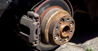 Brake disc with saddles and shoals close-up on the used car