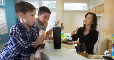 "Family plays with ""Alexa"" voice command personal assistant"