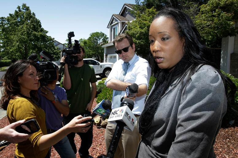 Ina Rogers talks with reporters about the seizure of her 10 children by law enforcement Monday, May 14, 2018, in Fairfield, Calif. Authorities removed the children living at their home on March 31, and placed them in protective custody after one of them r