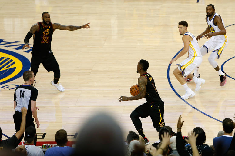 OAKLAND, CA - MAY 31: JR Smith #5 of the Cleveland Cavaliers dribbles in the closing seconds of regulation as LeBron James #23 attempts direct the offense against the Golden State Warriors in Game 1 of the 2018 NBA Finals at ORACLE Arena on May 31, 2018 i