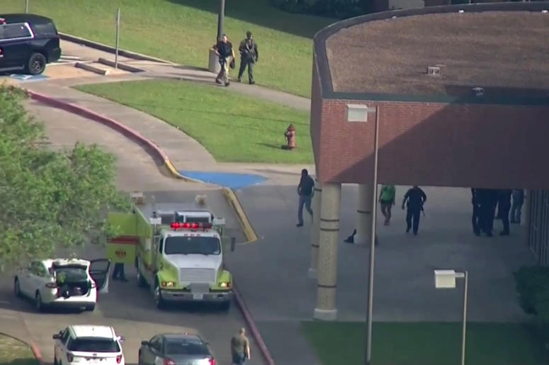 In this image taken from video law enforcement officers respond to a high school near Houston after an active shooter was reported on campus, Friday, May 18, 2018, in Santa Fe, Texas. The Santa Fe school district issued an alert Friday morning saying Sant