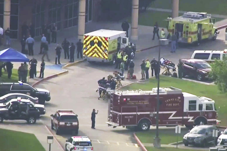 In this image taken from video emergency personnel and law enforcement officers respond to a high school near Houston after an active shooter was reported on campus, Friday, May 18, 2018, in Santa Fe, Texas. The Santa Fe school district issued an alert Fr