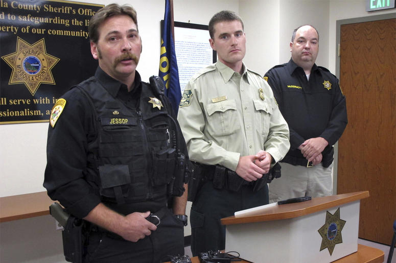 From left, Missoula County Sheriff's Deputy Ross Jessop, U.S. Forest Service Law Enforcement Officer Nick Scholz and Sheriff T.J. McDermott answer questions on Tuesday, July 10, 2018, in Missoula, Mont., about a baby found in the woods at least nine hours