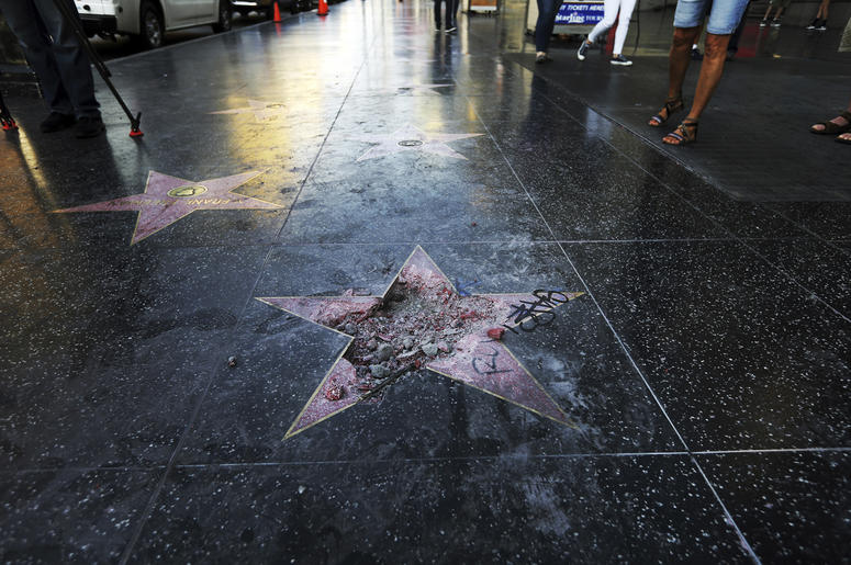 This photo shows Donald Trump's star on the Hollywood Walk of Fame that was vandalized Wednesday, July 25, 2018, in Los Angeles. Los Angeles police Officer Ray Brown said the vandalism was reported early Wednesday and someone was subsequently taken into c