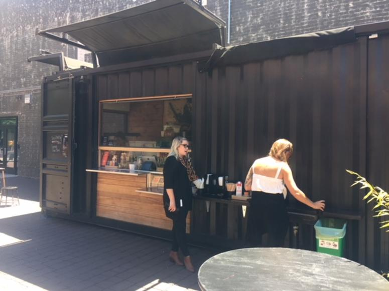 Customers get beverages at Red Bay Coffee's Oakland location, which is also in a shipping container.