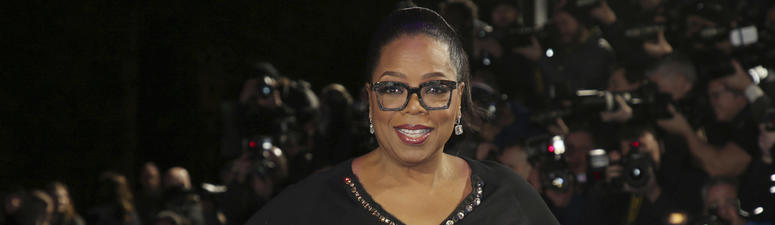 In this March 13, 2018, file photo, actress Oprah Winfrey poses for photographers upon arrival at the premiere of the film 'A Wrinkle In Time' in London. Apple said Friday, June 15, 2018, it has reached a multi-year deal with Winfrey to create original pr