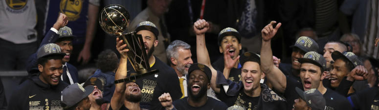 The Golden State Warriors celebrate after defeating the Cleveland Cavaliers 108-85 in Game 4 of basketball's NBA Finals to win the NBA championship, in Cleveland