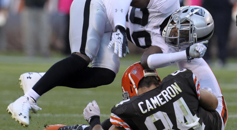 Cleveland Browns tight end Jordan Cameron left the game with a concussion after a hit by Oakland Raiders Brandian Ross during the second quarter on Sunday, Oct. 26, 2014, at FirstEnergy Stadium in Cleveland, Ohio. The Browns won the game 23-13. (Photo by