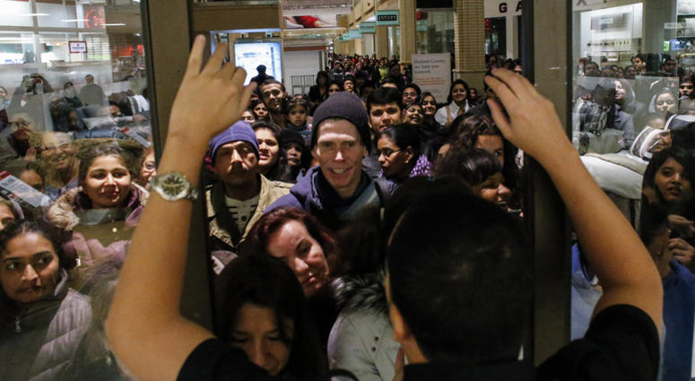 NEWPORT, NJ - NOVEMBER 27: People waits in line to go shopping at the to JCPenney store at the Newport Mall on November 27, 2014 in Jersey City, New Jersey. Black Friday sales, which now begin on the Thursday of Thanksgiving, continue to draw shoppers out
