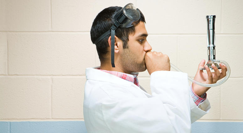 Male student performing an experiment (Photo credit: Shannon Fagan)