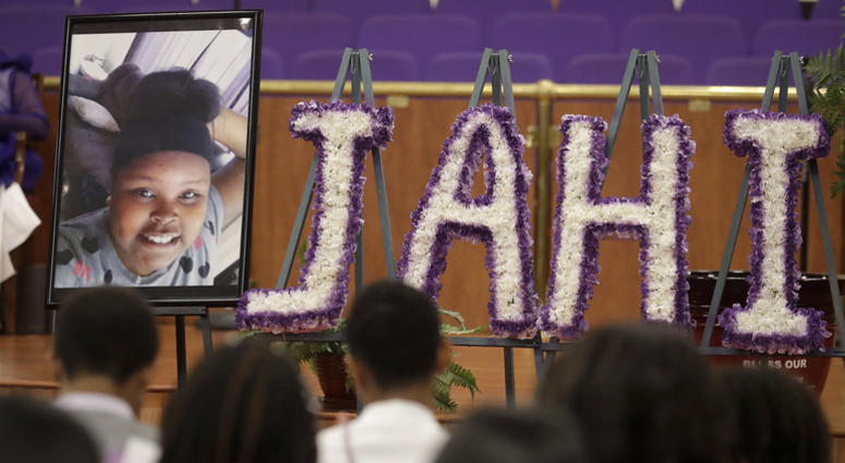 A photo of Jahi McMath is shown at funeral services for McMath at Acts Full Gospel Church in Oakland, Calif., Friday, July 6, 2018. Dozens of family members, friends and other mourners filed into the Northern California church Friday for the funeral of th