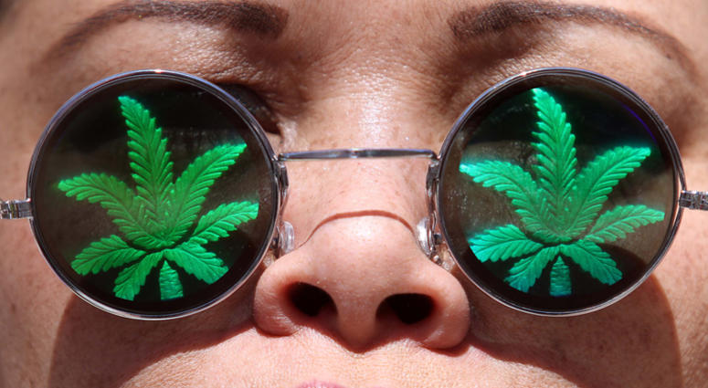 Lisa Marie, of Oakland, California, takes part in a 420 Day rally in front of the Federal Building in downtown Oakland on Friday, April 20, 2012.