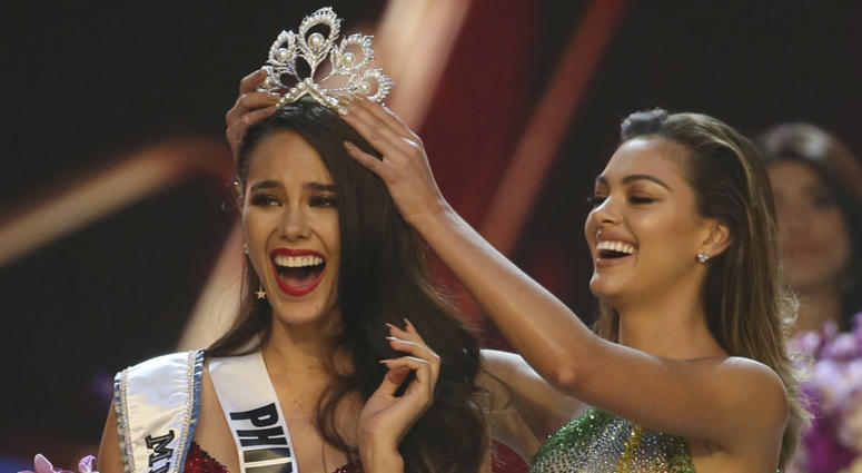 Catriona Gray of the Philippines, left, reacts as she is crowned the new Miss Universe 2018 by Miss Universe 2017 Demi-Leigh Nel-Peters during the final round of the 67th Miss Universe competition in Bangkok, Thailand, Monday, Dec. 17, 2018.(AP Photo/Gemu