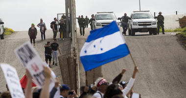 "April 29, 2018; San Ysidro, CA, USA; U.S. Border Patrol are seen at International Friendship Park as the ""March Without Borders\"" rally takes place in support of   the migrant caravan which had arrived in Tijuana earlier in the week. The members of the c"