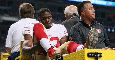 San Francisco 49ers running back Reggie Bush is carted off the field after being injured on a punt return during first quarter action on Sunday, Nov. 1, 2015, at Edward Jones Dome in St. Louis. (Photo by Chris Lee/St. Louis Post-Dispatch/TNS)