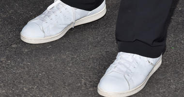 """American tennis legend Stan Smith wears a pair of Adidas """"Stan Smith"""" tennis shoes as he attends Day Three of the 2016 US Open at the USTA Billie Jean King National Tennis Center in the Flushing neighborhood of the Queens borough of New York, NY on August"""