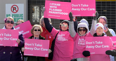 Planned Parenthood members from Nashville protest at Municipal Auditorium before the start of the rally by President Donald Trump.