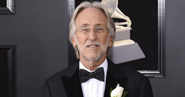 In this Jan. 28, 2018 file photo, Neil Portnow arrives at the 60th annual Grammy Awards in New York. Portnow will step down as president and CEO of The Recording Academy and the Grammy Awards next year. The organization announced Thursday, May 31, that Po