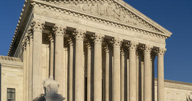 In this April 20, 2018, file photo, the Supreme Court is seen in Washington. The Supreme Court has upheld President Donald Trump's ban on travel from several mostly Muslim countries, rejecting a challenge that it discriminated against Muslims or exceeded