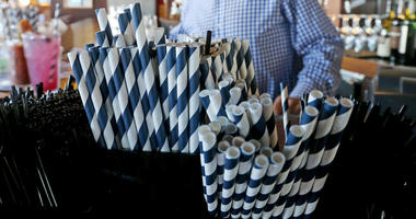 In this June 19, 2018 photo, paper straws sit at Duke Moscrip, owner of Duke's Restaurants, bar at his restaurant in Seattle. Businesses that sell food or drinks won't be allowed to offer the plastic items under a rule that went into effect Sunday, July 1