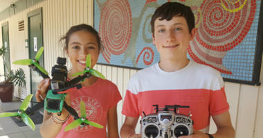 Matteo Almagere, 16, and his sister Nola, 13, display a drone that he built. Matteo is teaching a course on building and operating drones at a Marin County summer camp.