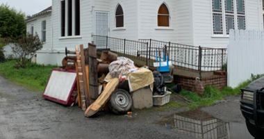 Items ruined by recent flooding of the Russian River are piling up around Guerneville.