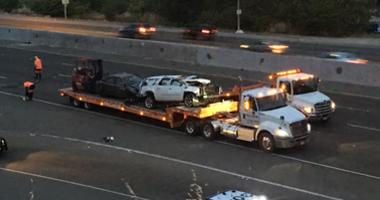 Crashed vehicle and tow truck