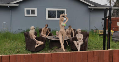 A Santa Rosa man has put mannequins on display in his yard after getting an anonymous complaint that his fence exceeded regulated heights.