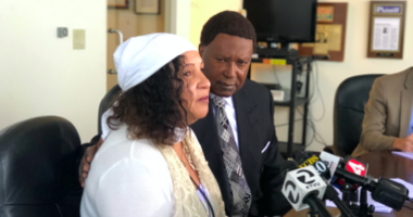 Yolanda Banks Reed sits next to her attorney John Burris and decries that a BART police officer will not be charged in the shooting death of her son Sahleem Tindle