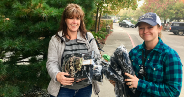 Roxanne Haugse left) and Katie Beal receive sweatshirts from Sierra Nevada Brewing, which has contributed to relief efforts for a wildfire that tore through Butte County near their headquarters.