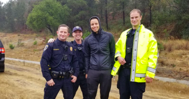 Golden State Warriors guard Stephen Curry poses with law enforcement after being involved in a 3-car accident in Oakland