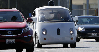 A Google self-driving car travels eastbound on San Antonio Road in Mountain View, Calif.