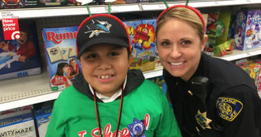 """Police from San Jose and other Silicon Valley departments helped buy Christmas gifts with kids through the """"Shop with a Cop"""" program."""
