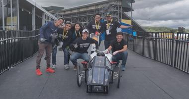 Guatemalan engineering students show off their entry into the Shell Eco-Marathon at Sonoma Raceway.