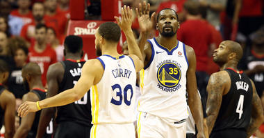 Golden State Warriors guard Stephen Curry (30) and forward Kevin Durant (35)
