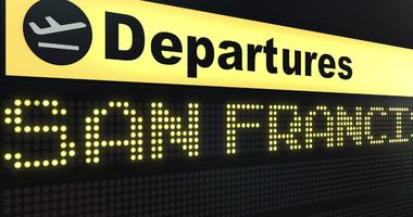 A departure sign at an airport.