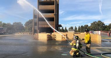 Firefighters demonstrate skills at the Contra Costa County Fire Protection District academy.