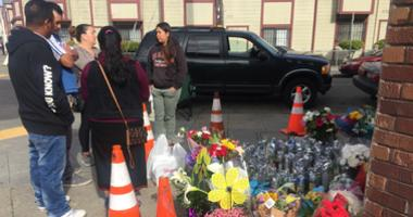 Mourners stopped at a roadside shrine in Oakland for a mother and her six-year-old son who were fatally struck by a hit-and-run driver on Foothill Boulevard on April 13, 2019.