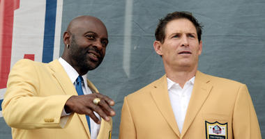 Former San Francisco 49ers Jerry Rice, left, and Steve Young.