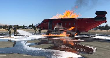 Firefighters train in Concord to put out a blaze in the event of an aircraft disaster.